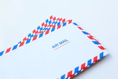 Blank airmail envelope stack. Over white Stock Photos