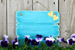Free Blank Antique Blue Sign With Purple Flowers (pansies) Stock Image - 39063101