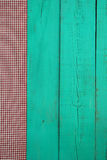 Blank antique green wooden sign with red checkered fabric border Stock Photos