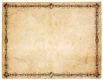 Blank Antique Paper With Victorian Border. Aged, yellowing paper with stains and smudges. Blank except for very ornate victorian border. Isolated on white stock image