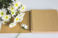 Blank area note book or diary with flower Stock Photo