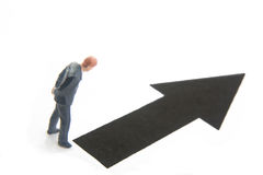 Blank Arrow. Miniature businessman figure with blank black arrow Stock Image