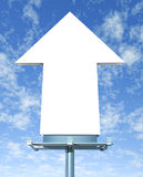 Blank Arrow Billboard. On a blue sky as an outdoor direct marketing display showing the upward direction of the announcement or positive message Stock Photography