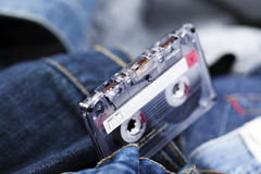 Audio Cassette on Denim Stock Images
