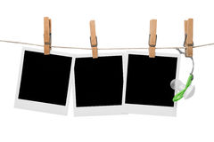 Baby photo frames. Blank baby photo frames hanging on line with soother Royalty Free Stock Images
