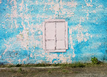 Blank background for your text. The texture of a grunge old street on the facade wall with cracked paint Stock Image