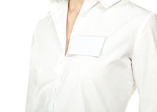 Blank badge attached to the shirt of woman Stock Image