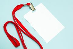 Blank badge mockup isolated on blue. Plain empty name tag with red string stock images