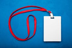 Blank badge mockup isolated on blue with red ribbon stock photo