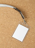 Blank badge with neckband on corkboard background. Blank badge with neckband on corkboard background Stock Image