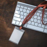Blank badge with red tape on the keyboard. 3d rendering Royalty Free Stock Photo