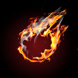 Blank ball on fire. Flying on black background royalty free stock images