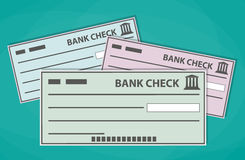 Blank bank checks isolated on green background Royalty Free Stock Image
