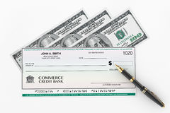 Blank Banking Check and Fountain Pen with Dollars Bills Stock Images