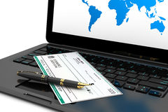 Blank Banking Check and Fountain Pen over laptop keyboard. On a white background Royalty Free Stock Photo