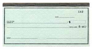 Blank Cheque. A blank banking cheque, attached to its cheque book. Isolated on white Royalty Free Stock Photography