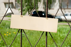 Blank banner on the fence iron lattice. Stock Photos