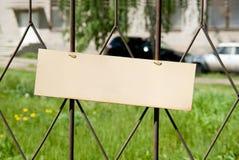 Blank banner on the fence iron lattice. Stock Photos