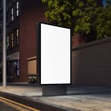 Blank banner on a night street next to brick red wall. 3d rendering. Blank banner on a night street in the city next to brick red wall. 3d rendering Royalty Free Stock Photography