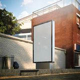 Blank banner on a street in the city next to brick red wall. 3d rendering Royalty Free Stock Images