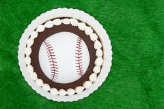Blank baseball cake on a green fake grass