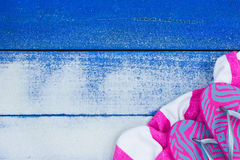 Blank beach sign with sand texture, beach towel and sandals Stock Photos