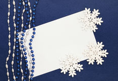Blank, beads and snowflakes on dark blue Royalty Free Stock Images