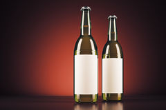 Blank beer bottles. With clear logo on red background. Ad concept. Mock up, 3D Rendering Royalty Free Stock Image