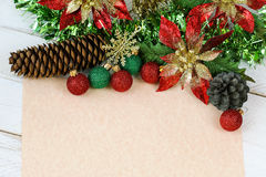 Blank beige paper to write wish lists with Christmas decoration Stock Photos