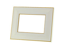 Blank beige wooden picture frame with golden border, isolated on Stock Photos