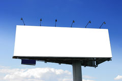 Blank big billboard. Over blue sky, put your own text here royalty free stock images