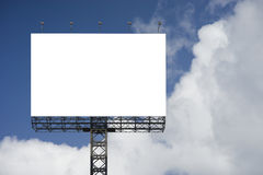 Blank big billboard against blue sky background,for your advertising,put your own text here,isolate white on board. Royalty Free Stock Photo