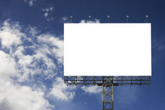 Blank big billboard against blurred blue sky background,for your advertising,put your own text here,isolate white on board Royalty Free Stock Image