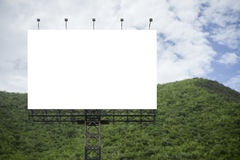 Blank big billboard against green mountain and blue sky background,for your advertising,put your own text here Stock Image