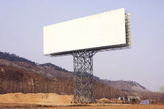 Blank big billboard over blue sky. Put your own text here Stock Photography