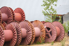 Blank big cable reels of metal for storing data cable. Stock Image