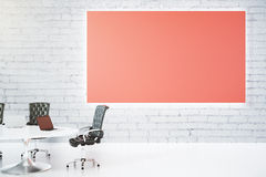Blank big red poster on white brick wall and table with leather Stock Image
