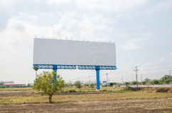 Blank big sign near highway with dry country Royalty Free Stock Photo