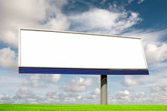 Blank bilboard. In a green field royalty free stock image