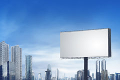 Blank bilboard on the city. With building and blue sky background, you can put your design on here royalty free stock images
