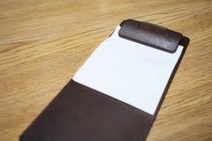 Blank bill receipt on table Stock Photo