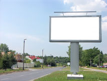 Blank billboard. Large blank billboard by the street stock photos