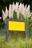 Blank billboard. Billboard sign in the country. yelow background. vertical composition stock photos