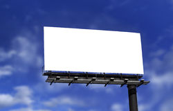 Blank billboard. Against blue sky, put your own text here stock photos