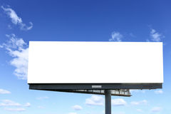 Blank billboard. Against blue sky, put your own text here stock photo