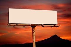 Blank billboard. Blank commercial advertisement billboard sunset on background royalty free stock photo