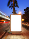 Blank billboard. On sidewalk of modern city royalty free stock image