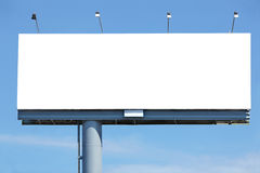 Blank billboard. Huge blank billboard against blue sky for your design stock photos