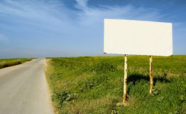 Blank billboard. In the middle of the country to write a message Stock Image