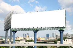 Blank billboard. With cityscape on sky stock photography